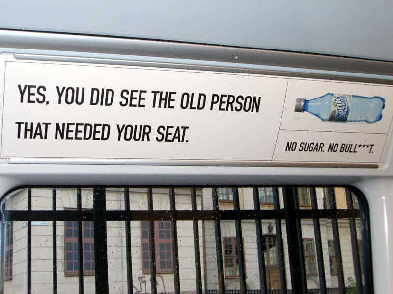 Old Person That Needed Yor Seat ad on a subway train