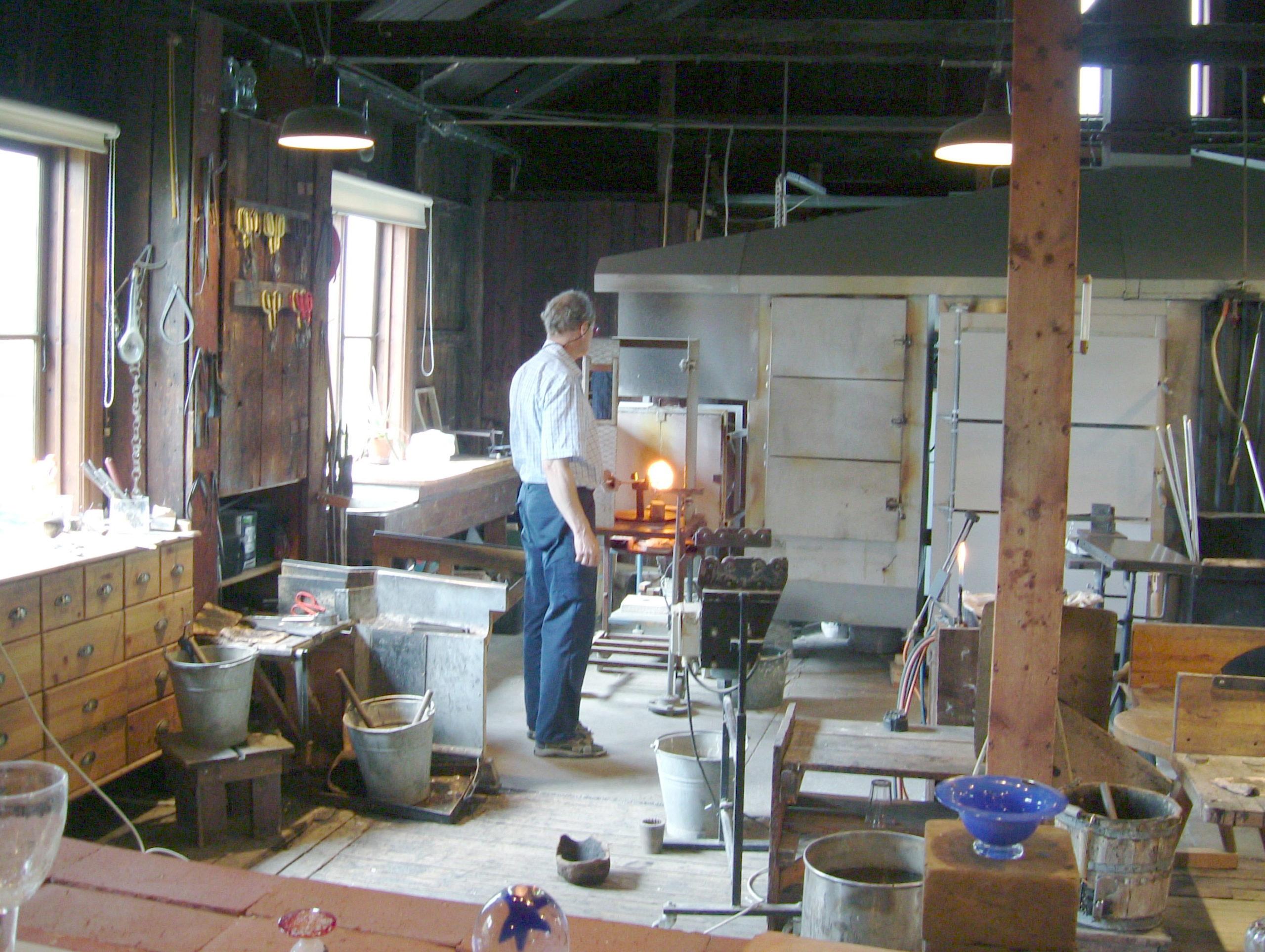 Glassmaker heats the glass in Skansen