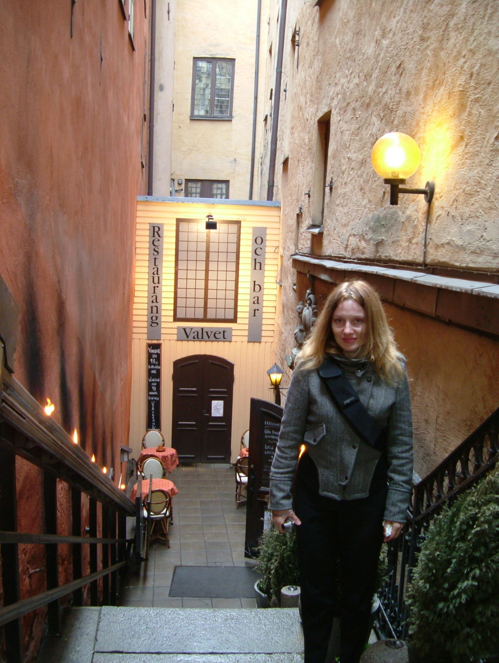 Me in an alley of stairs, leading to restaurant at the basement level in Stockholm Old Town