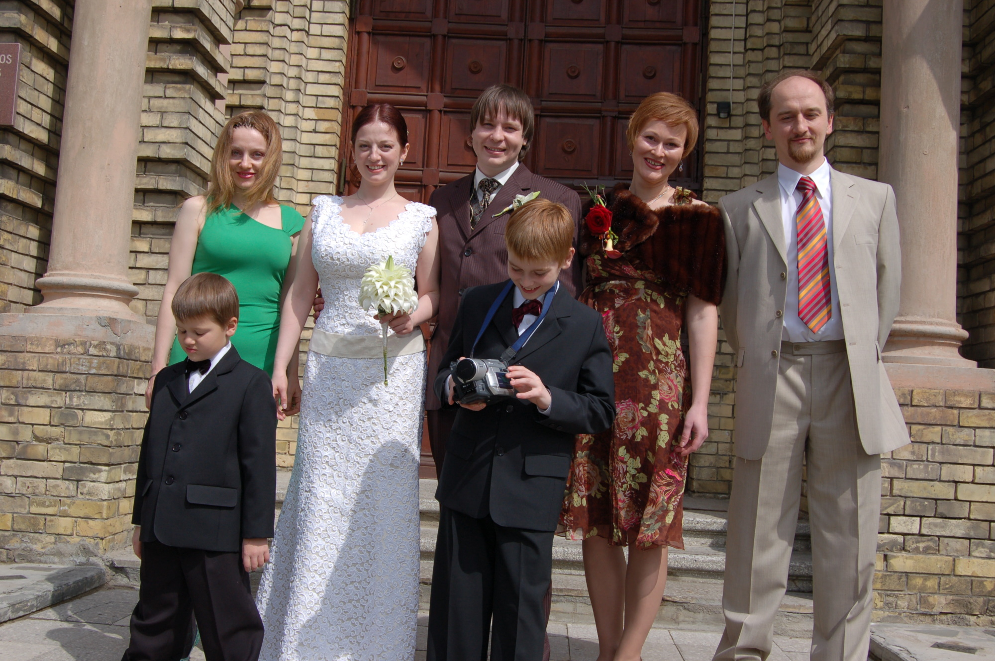 Me, my brother and his family, and the newlyweds
