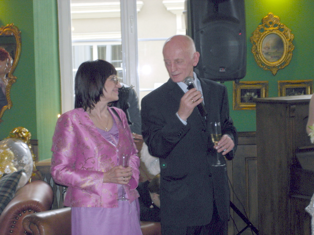 Mom and dad give a speech at the wedding reception