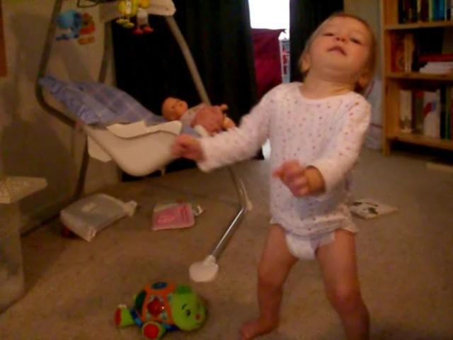 Baby tries to keep balance while walking
