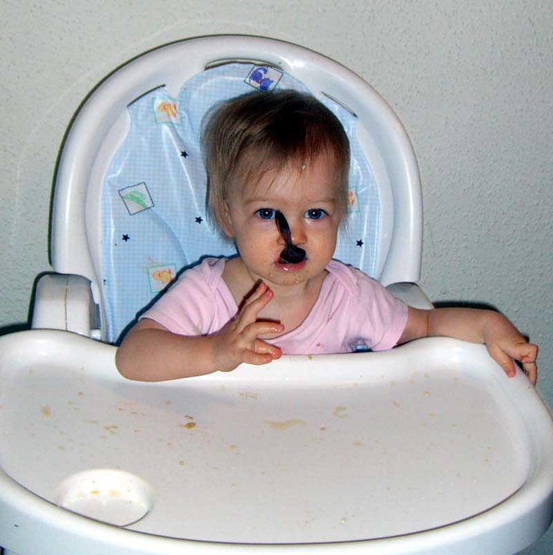 E with spoon in mouth