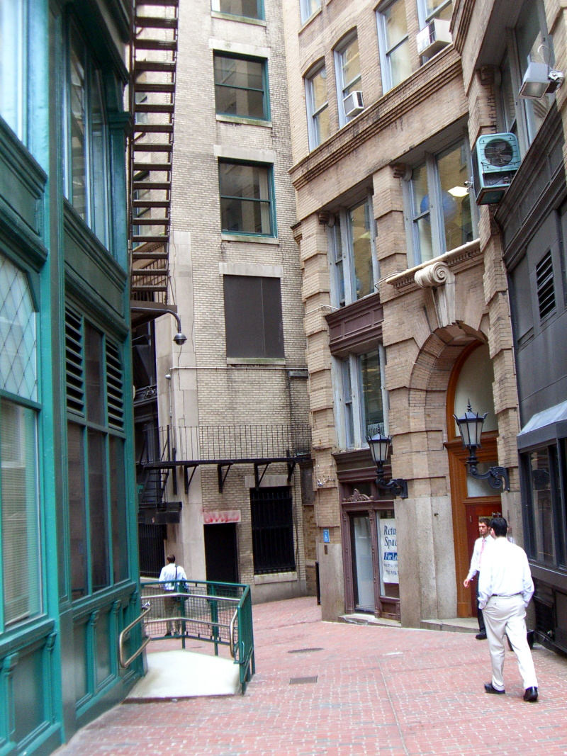 A corner of a narrow, curving street in Boston