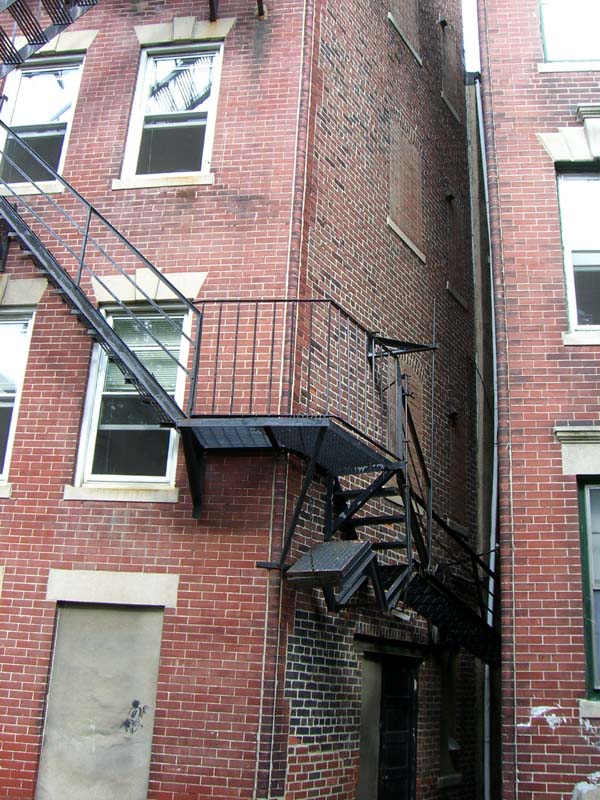 A fire escape wrapping around the corner of a house