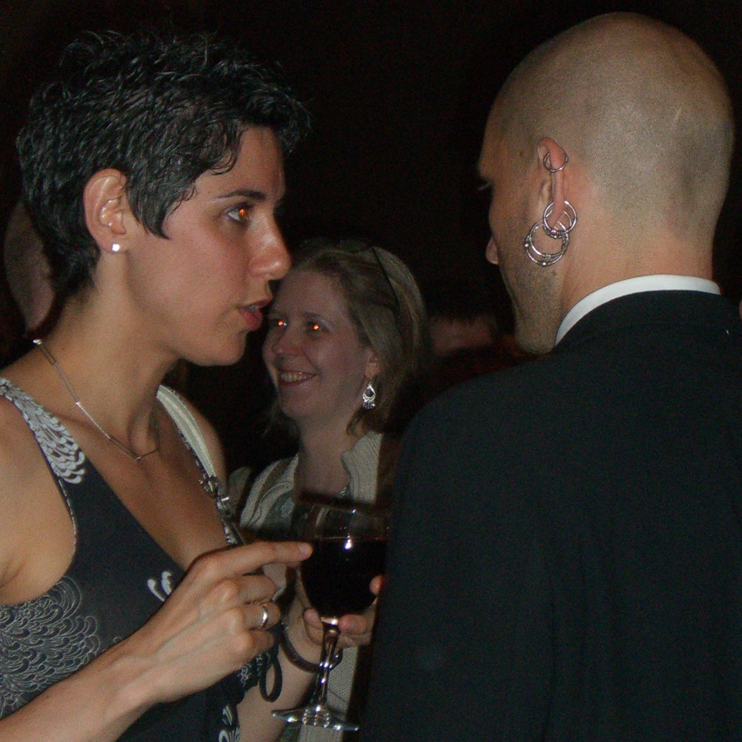 Jessie (left) and China Mieville's earrings at Readercon 2006