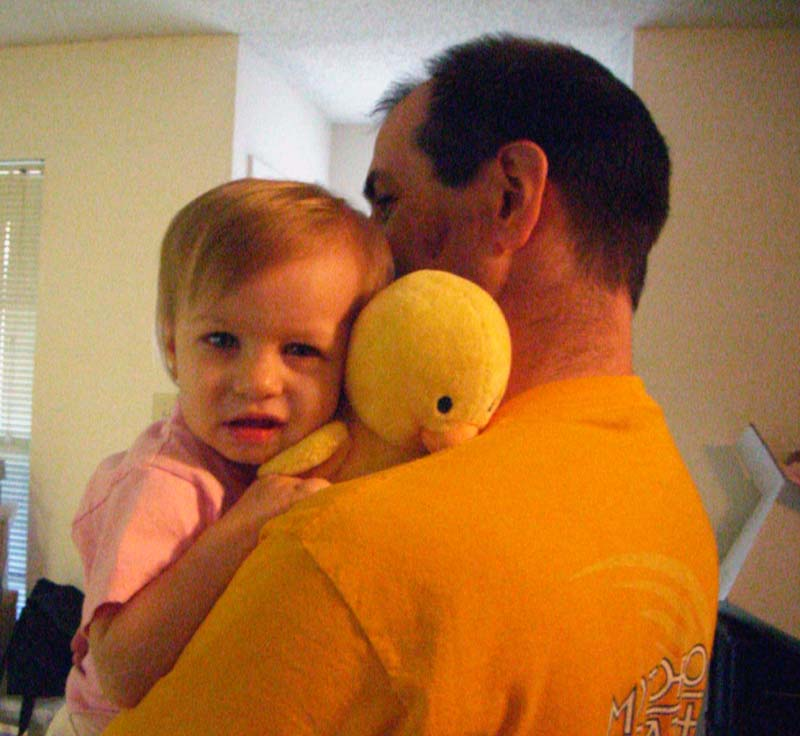 E held by S, holding a stuffed duck