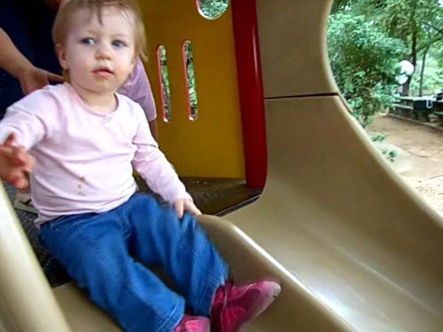 E is about to go down the slide