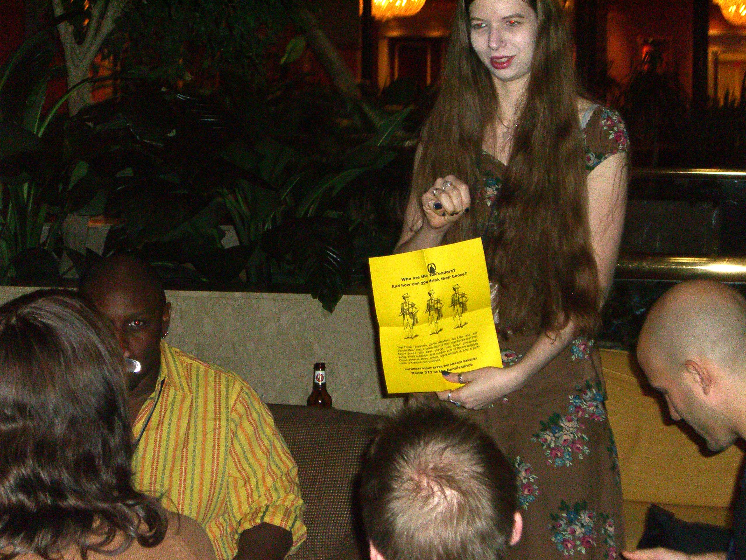 Editor LG with TOReadors party flyer at the World Fantasy Convention 2006
