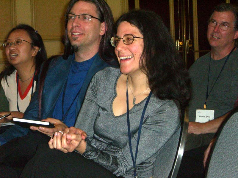 World Fantasy Convention 2006: Grá Linnaea, Jennifer Linnaea, and behind them, artist Charles Vess in the audience