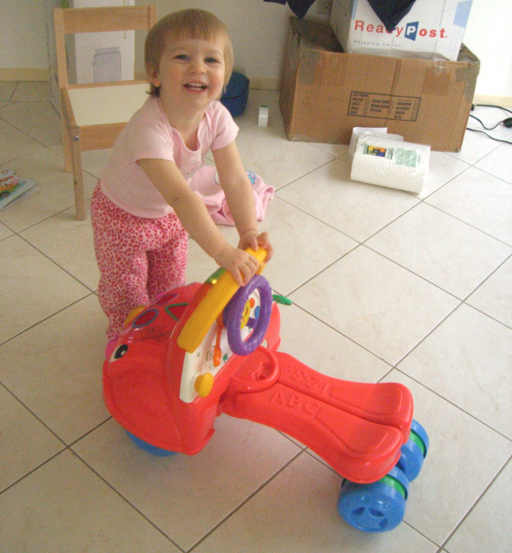 E with a red, ride-on toy car