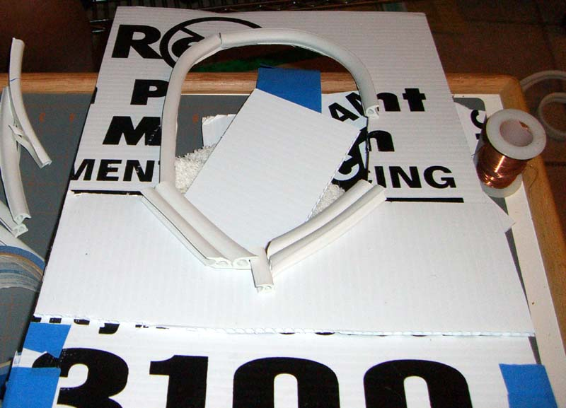 Cardboard frame with a face-shaped hole for face casting