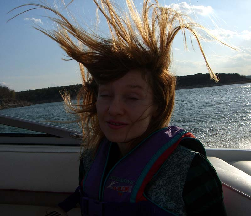 Me with wild hair on the boat