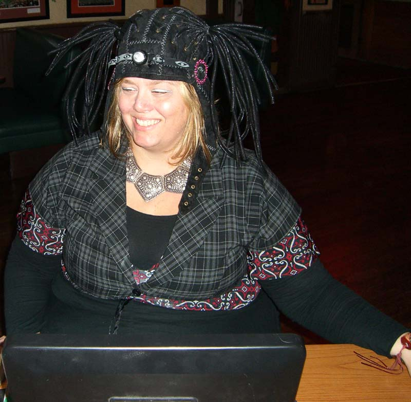 Ticket seller in a steampunk costume