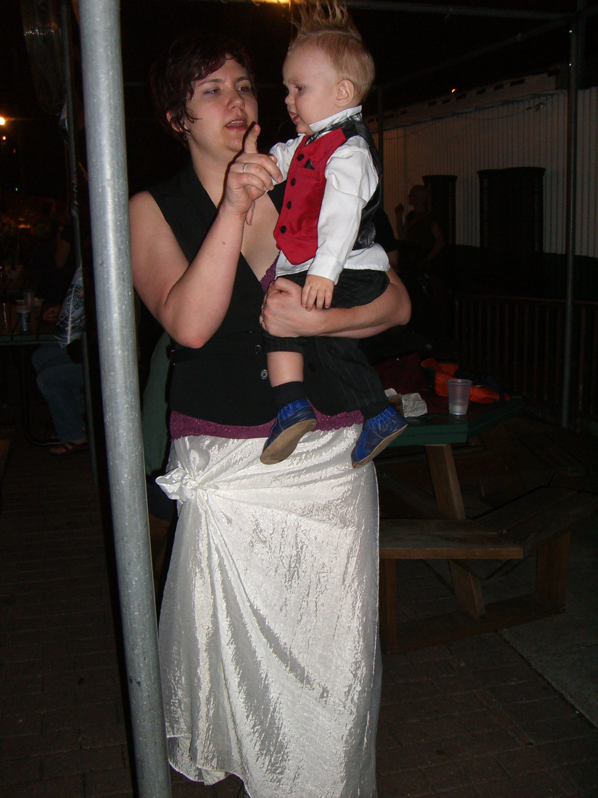 A mom and baby with a mohawk, both in steampunk costumes