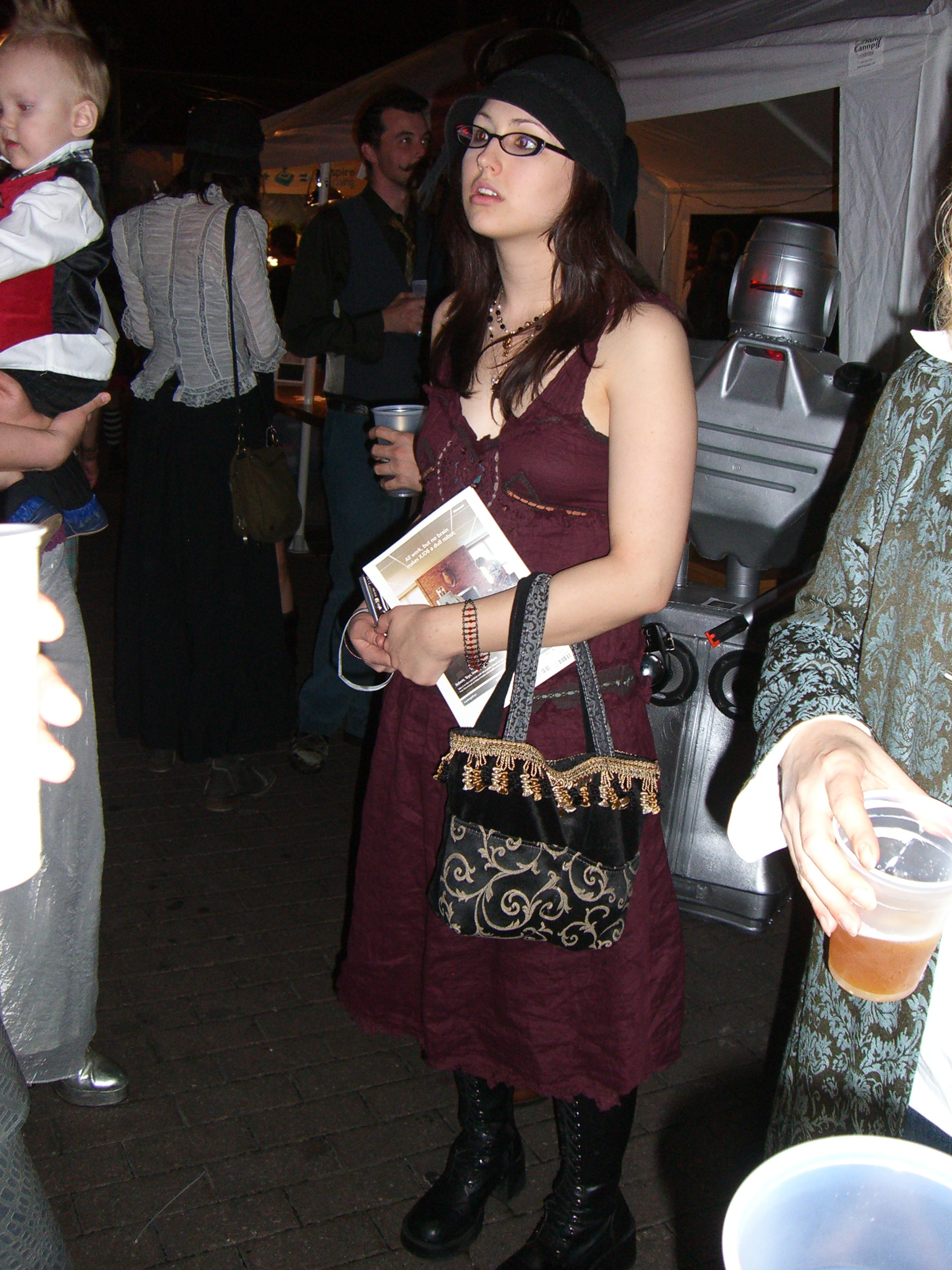 Purple dress and black hat at the steampunk party at SXSW 2007
