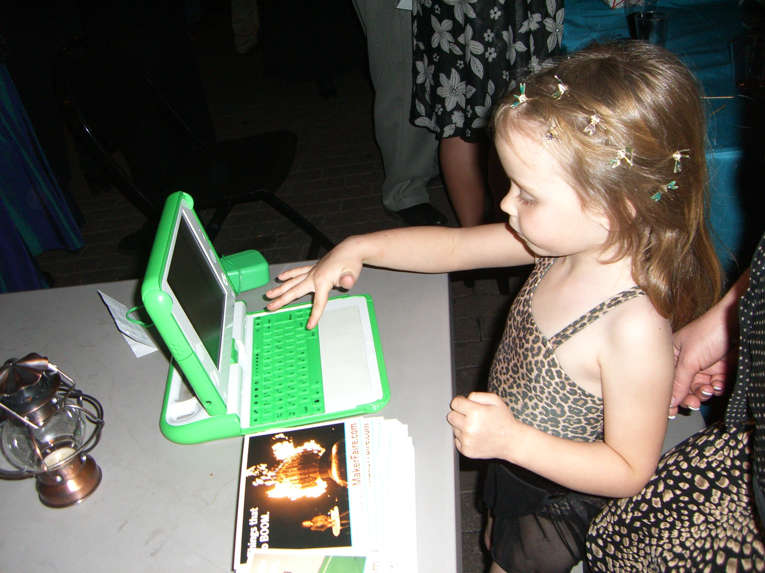 Typing on an OLPC / XO laptop at the steampunk party at SXSW 2007