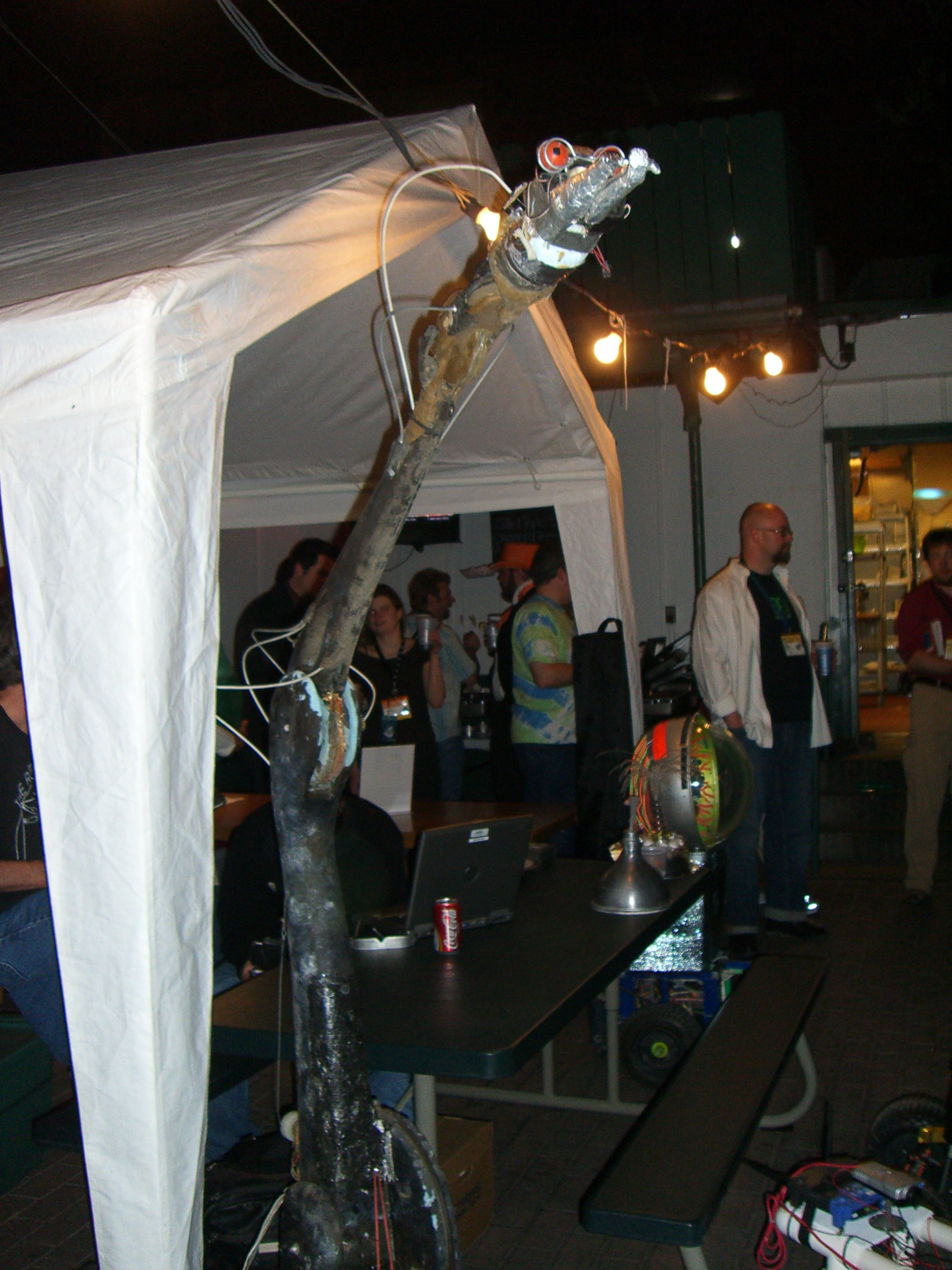 A robotic snake-like sculpture at the Robot Group booth