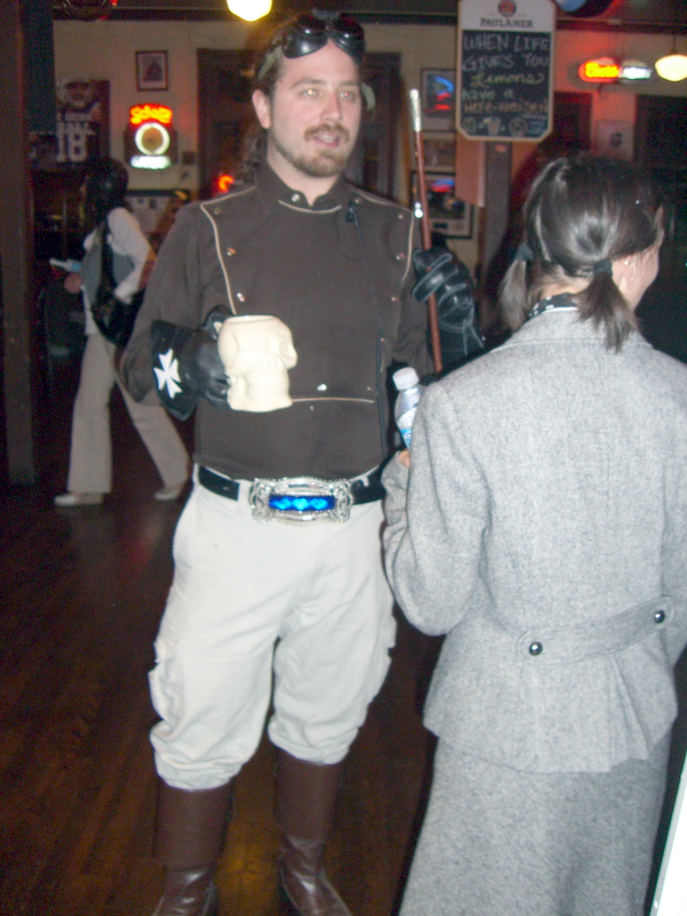 A military-themed steampunk costume with requisite goggles