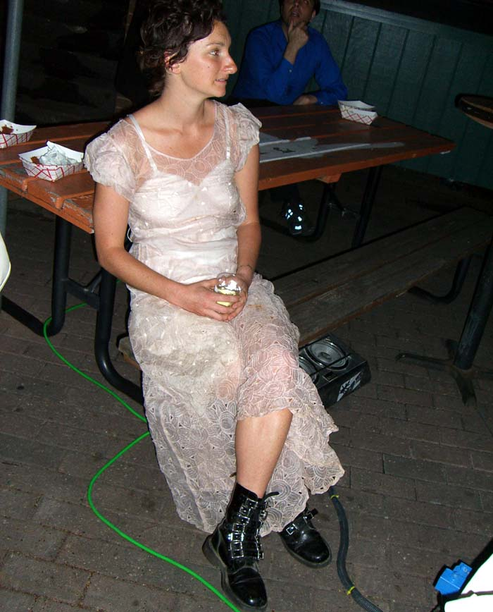 White lacy dress and black boots, seen at the steampunk party at SXSW 2007