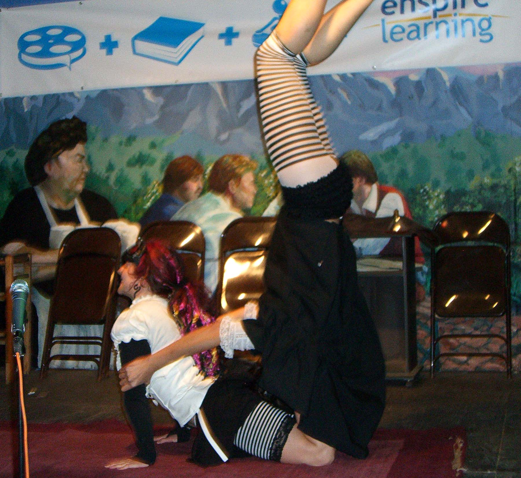Performance of a two person acrobat troupe Popsy Purvy at the SXSW 2007 Steampunk party