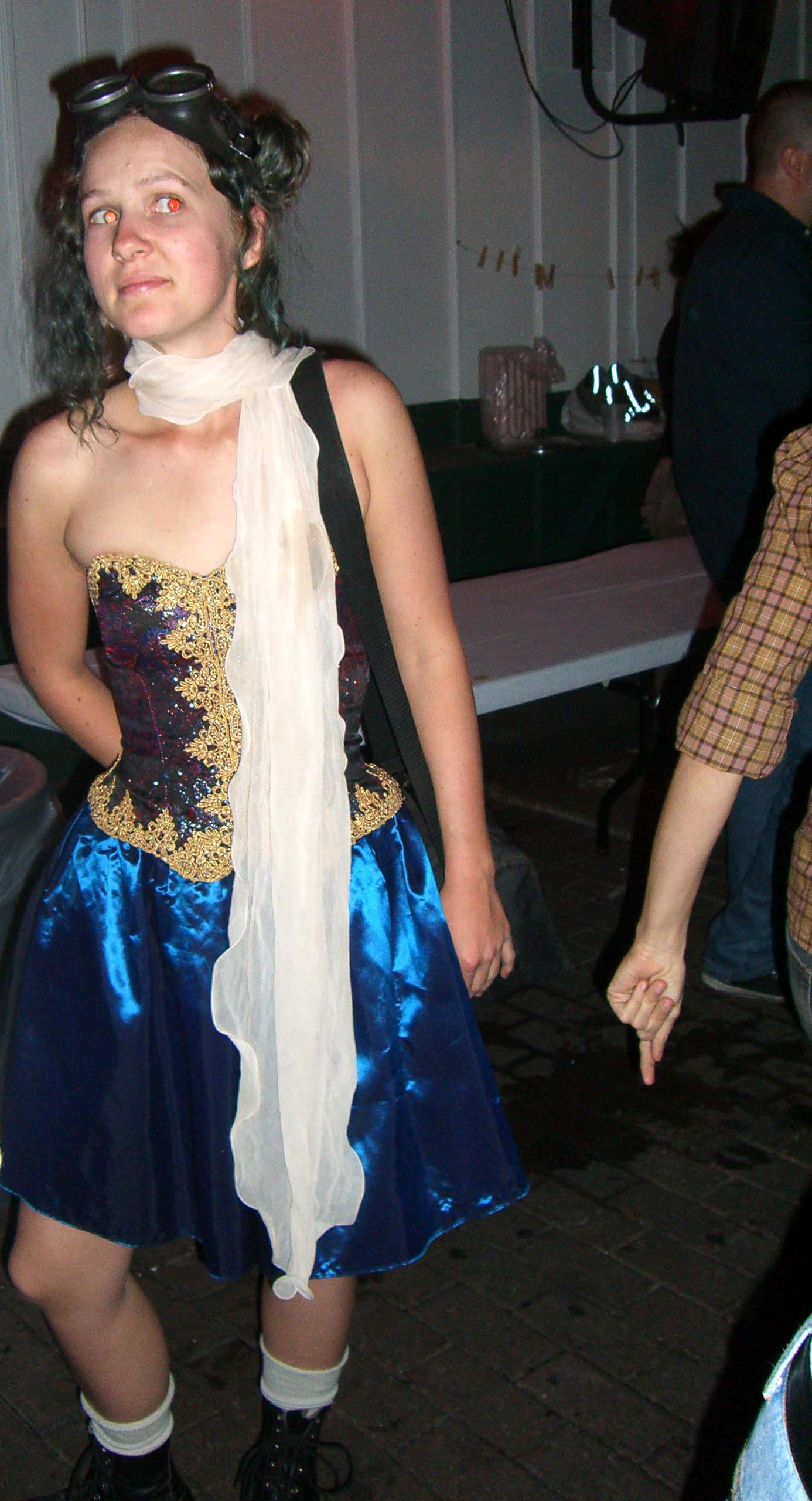 Gold-and-blue dress, long white scarf and goggles - Steampunk party at SXSW 2007