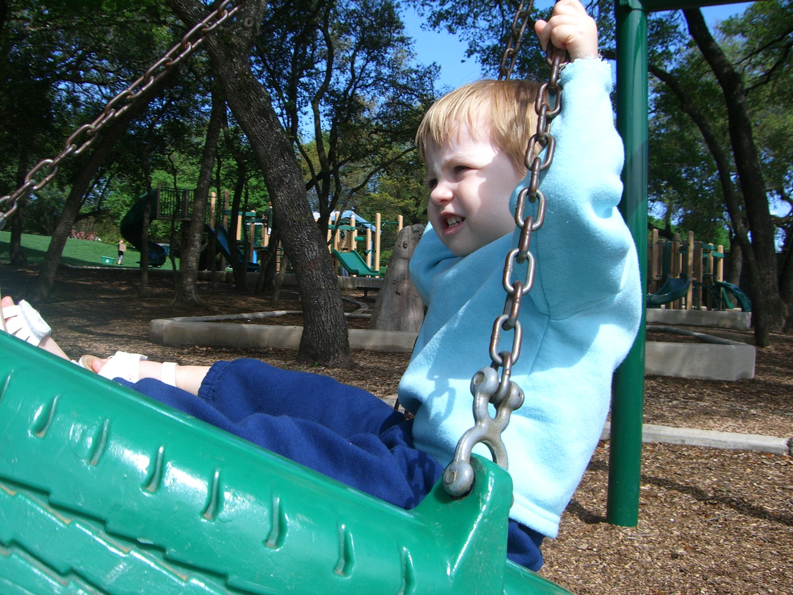 E on a playground in a tire swing, March 2007
