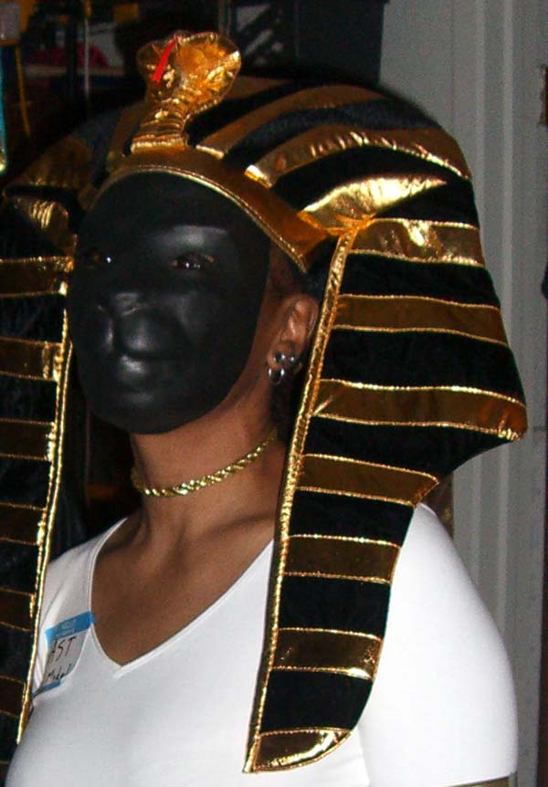 M in a mask of an Egyptian goddess Bast