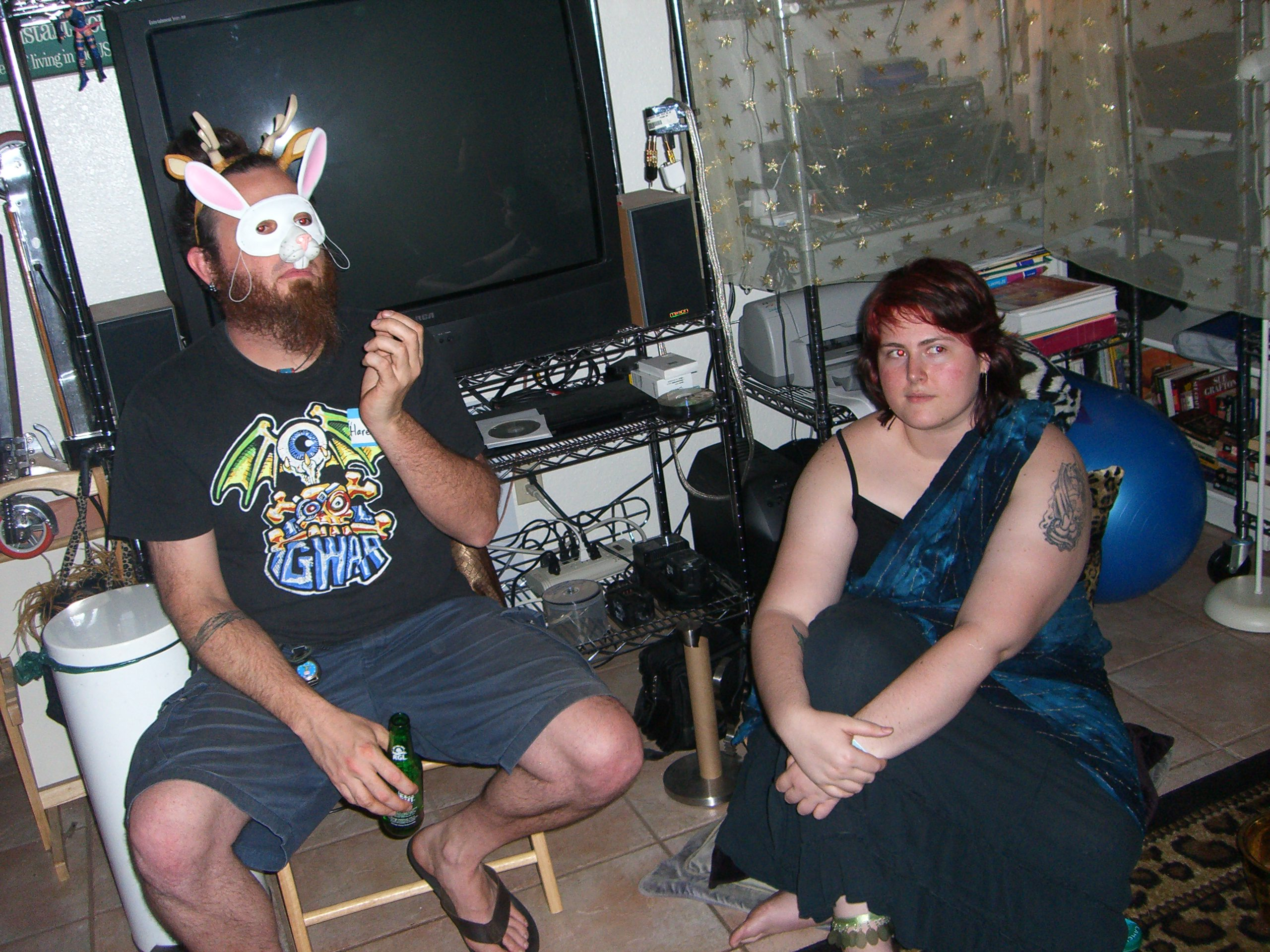 A guy in a Hare -- read, Hair -- Krishna costume, and Wendy as a sky god