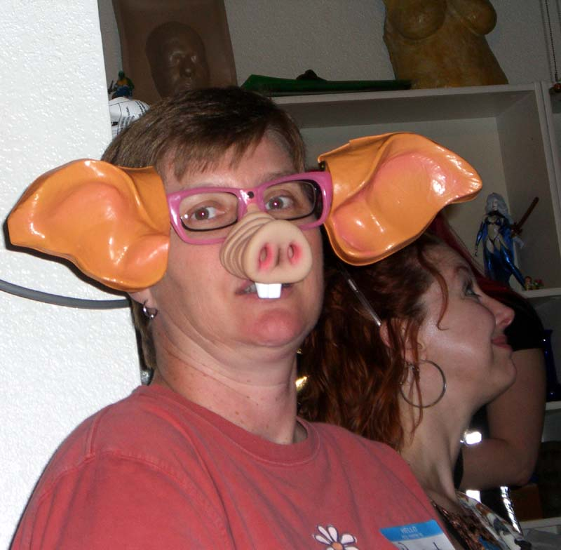 A pig mask at the second annual Ye Gods party