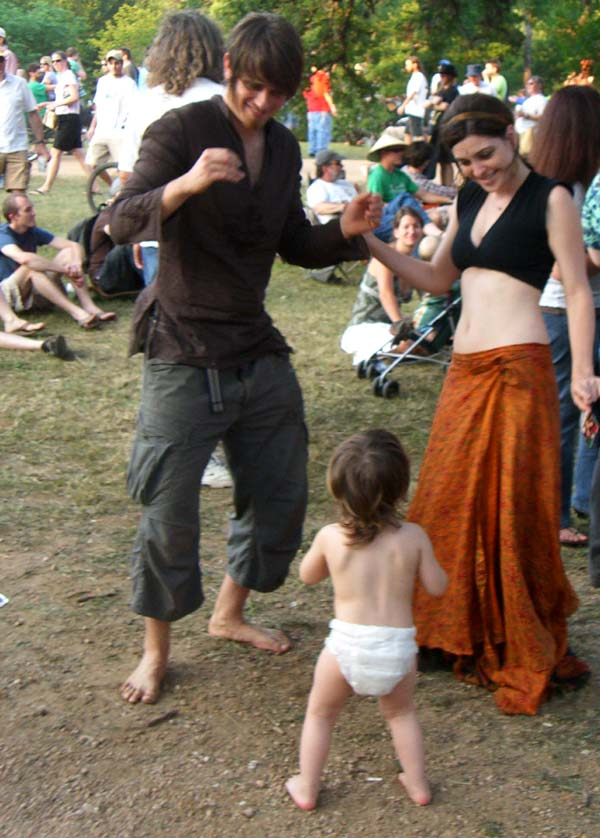 A young family dances to drums at Eeyore's Birthday 2007