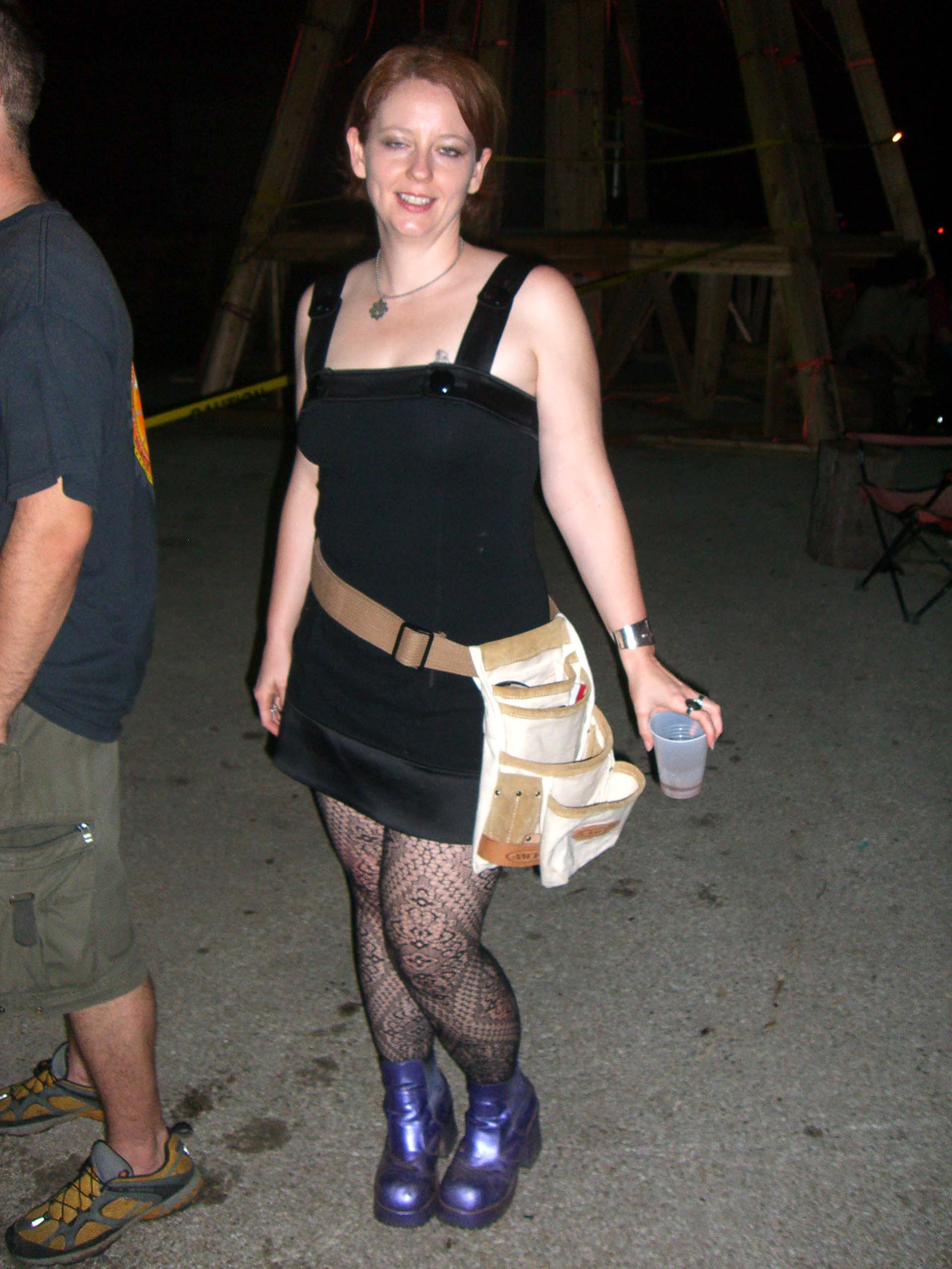 A black dress with a belt holding an intricate system of pockets, May 2007