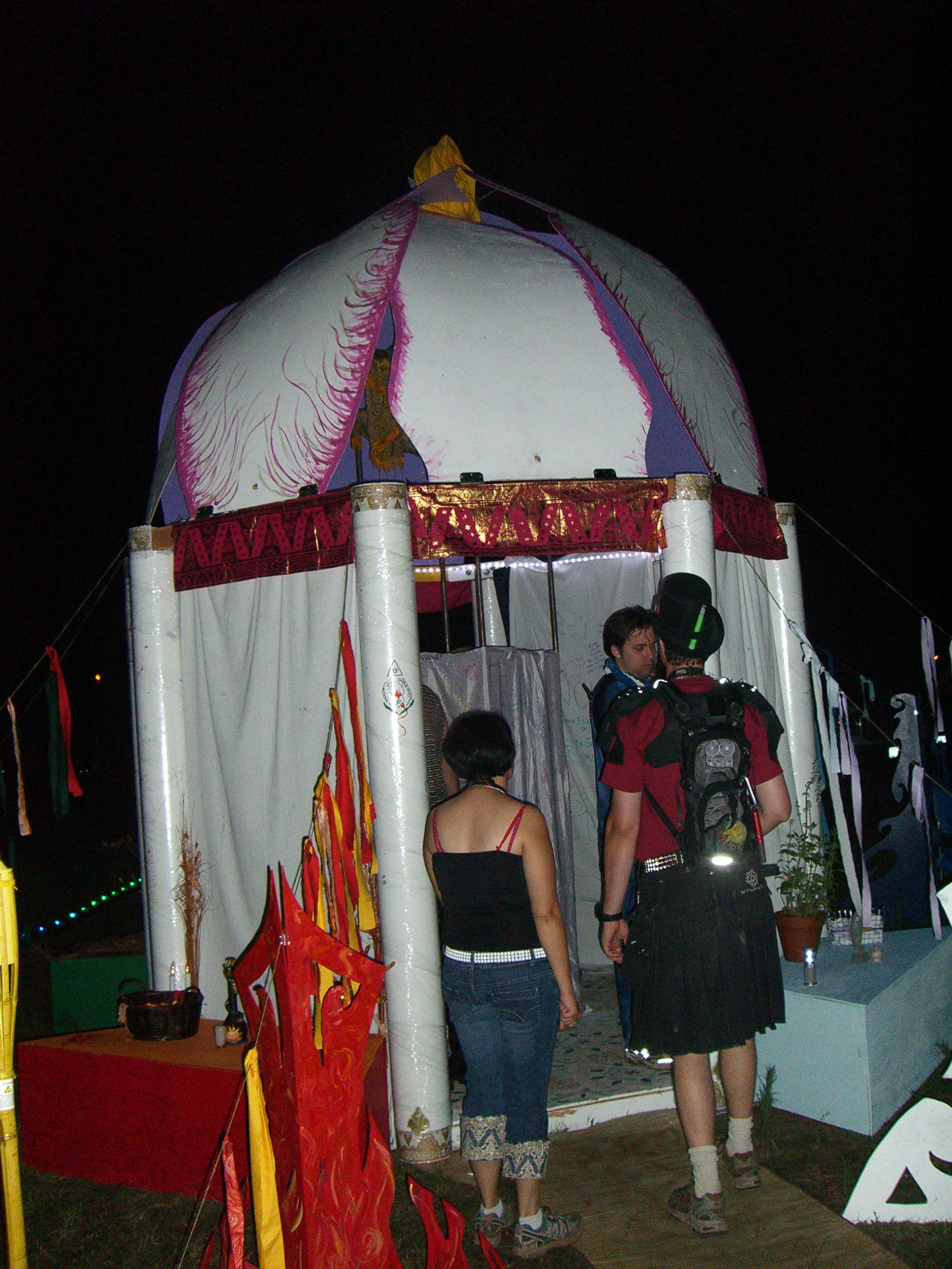 A booth with hanging fabric sheets for scribbling on